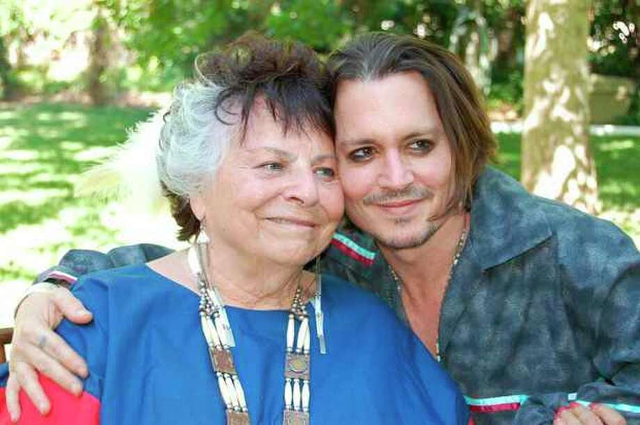 "This photo provided by Americans for Indian Opportunity shows LaDonna Harris, left, president of Americans for Indian Opportunity, poses with actor Johnny Depp at her Albuquerque, N.M., home on May 16, 2012. Harris invited Depp to become an adopted member of the Comanche Indian tribe in a private ceremony. Depp is currently filming the role of Tonto in ""The Long Ranger"" in New Mexico. (AP Photo/Courtesy of Americans for Indian Opportunity) / Americans for Indian Opportunity"