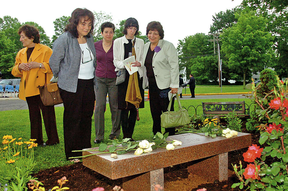 Family members including Luisa Mortelliti, Magaret Breen, Marie Tracy, Chloe MOrtelliti and Laura Limarzi look over memorial bench at a dedication ceremony Wednesday morning at West Rocks Middle School for former teacher Carla Mortellitti who died last year. Hour photo / Erik Trautmann / (C)2012, The Hour Newspapers, all rights reserved