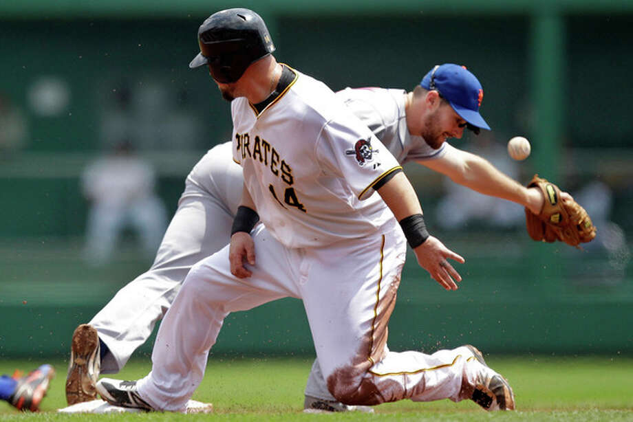 New York Mets second baseman Daniel Murphy, rear, can't handle the toss from shortstop Ronny Cedeno allowing Pittsburgh Pirates' Casey McGhee (14) to advance to second on a fielder's choice hit by Pirates' Yamaico Navarro during the second inning of a baseball game in Pittsburgh, Wednesday, May 23, 2012. (AP Photo/Gene J. Puskar) / AP