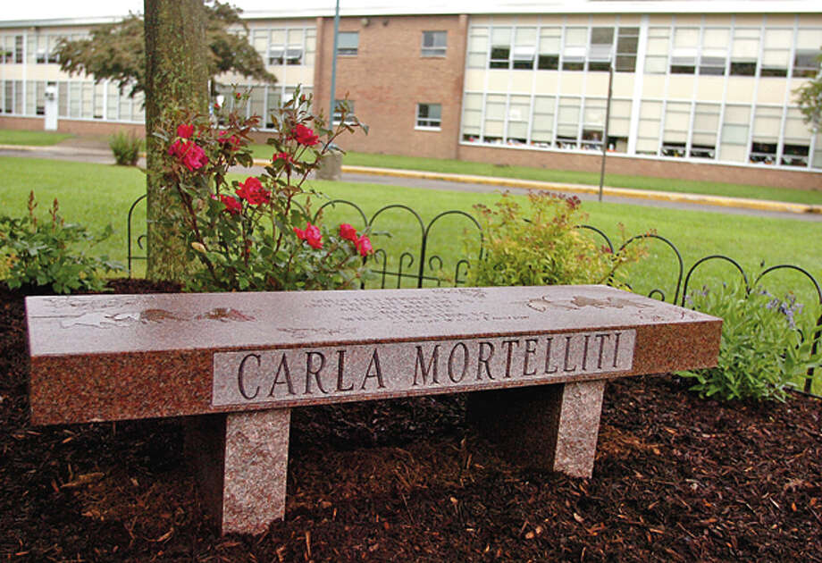 West Rocks Middle School held a dedication ceremony Wednesday morning for former teacher Carla Mortellitti where a bench was placed outside the school in her honor. Hour photo / Erik Trautmann / (C)2012, The Hour Newspapers, all rights reserved