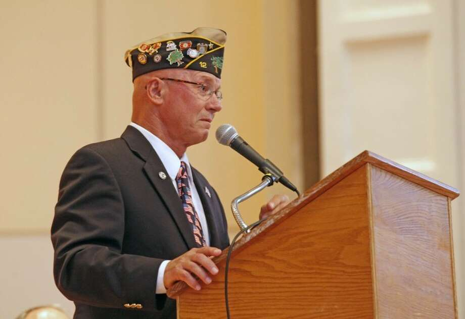 Veteran and Norwalk Veterans Memorial Committee Chairman Alfred Buddy Scudder speaks inside Norwalk City Hall during a ceremony in which a Veterans Hall of Honor was dedicated Thursday evening. Hour Photo / Danielle Robinson
