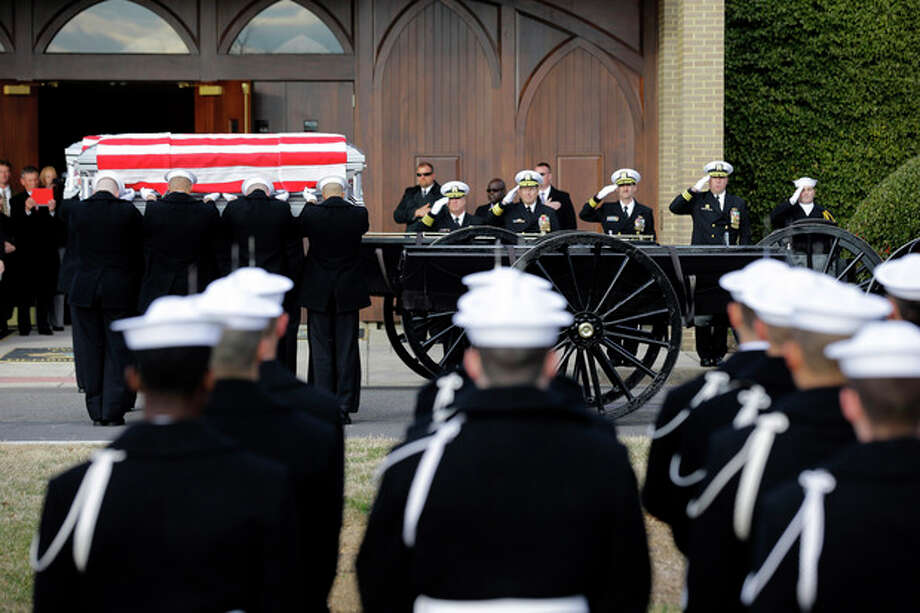 Two Navy Honor Guard teams load two caskets of remains during services to honor two sailors from the Civil War ship, the USS Monitor, as they depart Fort Meyer Memorial Chapel, Friday, March 8, 2013 in Arlington, Va. A century and a half after the Civil War ship the USS Monitor sank, two unknown crewmen found in the ironclad's turret were buried at Arlington National Cemetery. Friday's burial may be the last time Civil War soldiers are buried at the cemetery. (AP Photo/Alex Brandon) / AP