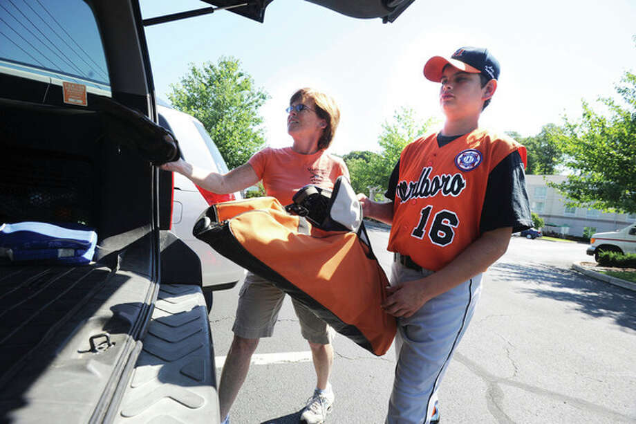Hour Photo / Matthew Vinci Cathy Terwedow and her son Willie from Marlboro, Mass., load up the car at the Hilton Garden Inn and head out to Brien McMahon High School Sunday for the Babe Ruth New England Tournament. / (C)2011, The Hour Newspapers, all rights reserved