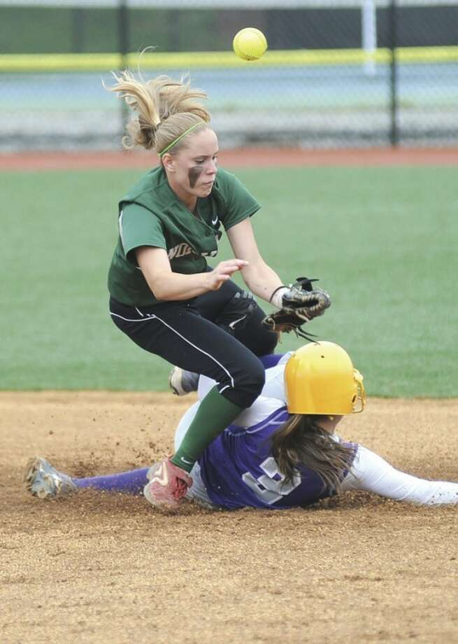 Hour photo/John NashNorwalk shortstop Katie Schmidt, top, is upended by the slide of Westhill's Allie Souza on a stolen base attempt in the first inning of Friday's FCIAC semifinal at Sacred Heart University in Fairfield. The top-seeded Vikings recorded a 7-4 victory over the Bears and will face Darien in Saturday's championship game.