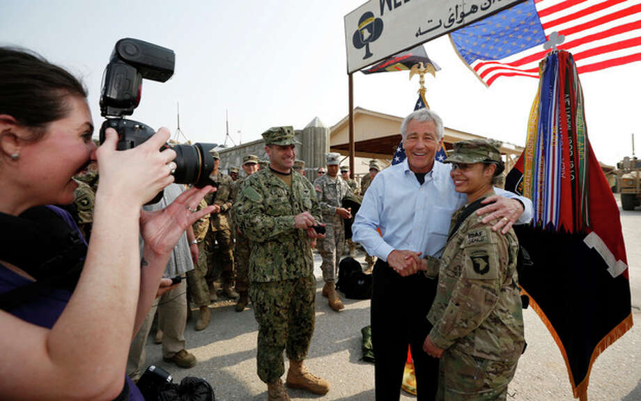U.S. Defense Secretary Chuck Hagel poses for a picture with a member of the U.S. Army 101st Airborne Division during his visit to Jalalabad Airfield in eastern Afghanistan, Saturday, March 9, 2013. It is Hagel's first official trip since being sworn-in as President Barack Obama's defense secretary. (AP Photo/Jason Reed, Pool) / Pool Reuters
