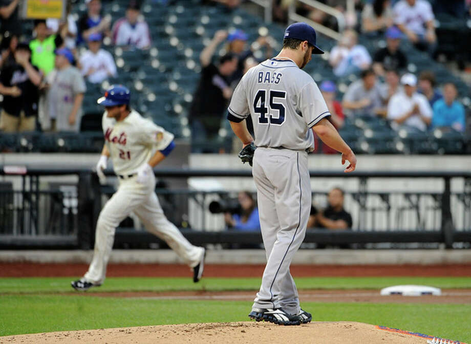 San Diego Padres starting pitcher Anthony Bass (45) reacts on the mound as New York Mets' Lucas Duda (21) rounds third base after hitting a solo home run in the second inning of a baseball game on Friday, May 25, 2012, at Citi Field in New York. (AP Photo/Kathy Kmonicek) / FR170189 AP