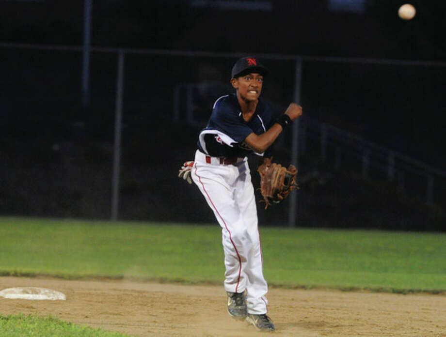 Norwalk's Edwin Owolo throws to first vs. Plymouth on Monday. hour photo/matthew vinci / (C)2011, The Hour Newspapers, all rights reserved