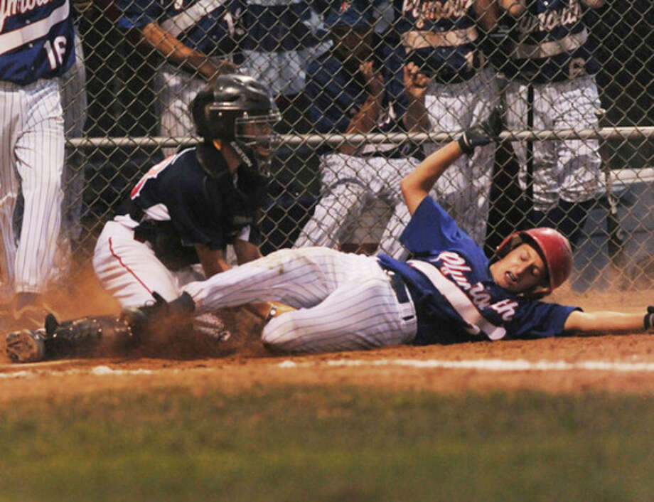 Plymouth player Ryan Bodreau is tagged out at home by Norwalk catcher Corey Hayes in the Babe Ruth Regional Tournament at Brien McMahon High School. hour photo/matthew vinci / (C)2011, The Hour Newspapers, all rights reserved