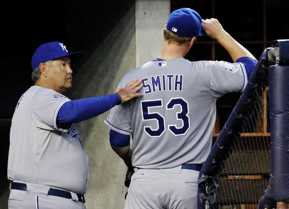Kansas City Royals bench coach Chino Cadahia, left, consoles starting pitcher Will Smith (53), who came out in the fourth inning after allowing three home runs to the New York Yankees, during their baseball game at Yankee Stadium in New York, Wednesday, May 23, 2012. (AP Photo/Kathy Willens) / AP