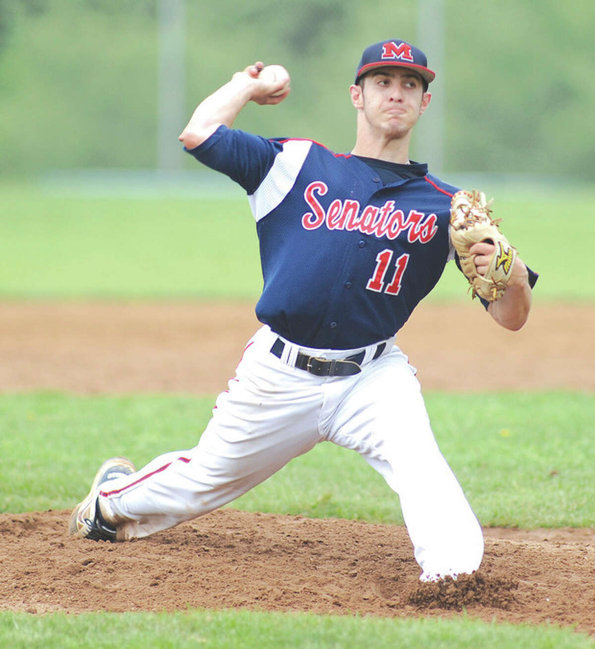 Hour Photo/John Nash Brien McMahon pitcher Bryan Daniello fired a two-hitter, striking out 10 and walking not a soul, as the Senators topped Wilton, 4-1, in FCIAC quarterfinal baseball action.
