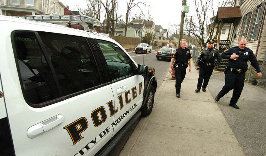 Hour Photo/ Alex von Kleydorff. Norwalk Police investigate the scene of a stabbing on So. Main St on Wednesday