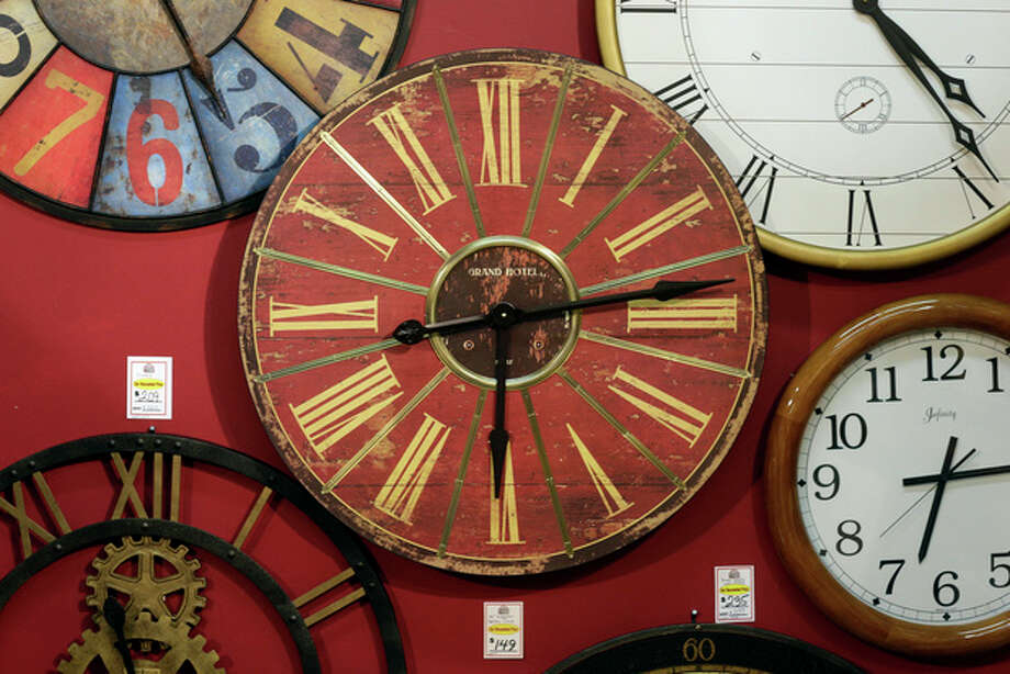 Clocks hang on a wall in Hands of Time, a clock store and repair shop in Savage, Md., Friday, March 8, 2013. It's the weekend to spring ahead for daylight saving time. Officially, the change starts Sunday at 2 a.m., and most Americans will get an hour less sleep but will gain an hour more of evening sunlight in the coming months. Not every place makes the switch. The exceptions are Hawaii, most of Arizona, Puerto Rico, the Virgin Islands, American Samoa, Guam and the Northern Marianas. (AP Photo/Patrick Semansky) / AP