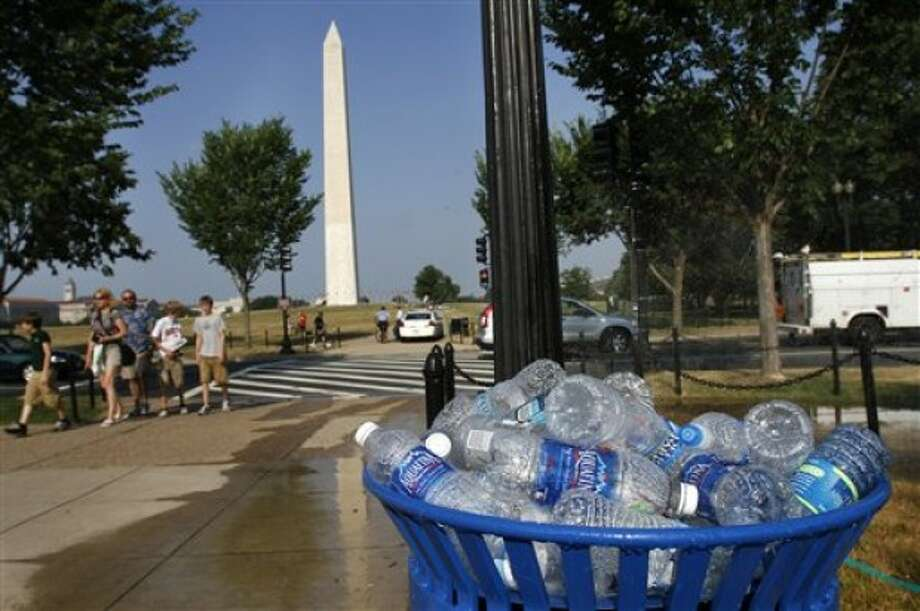 A recycling bin is full of discarded water bottles on the National Mall in Washington, on Wednesday, June 8, 2011. The mercury climbed into the 90s across half the country Wednesday in a record-breaking blast of August-like heat, forcing schools with no air conditioning to let kids go home early and cities to open cooling centers. And scientists say we had better get used to it. (AP Photo/Jacquelyn Martin)
