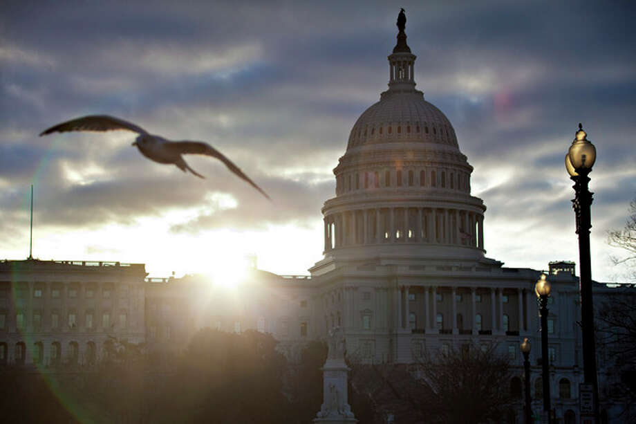 FILE – In this March 7, 2013, file photo the sun breaks through clouds over the U.S. Capitol in Washington. Daylight-saving time begins at 2 a.m. Sunday, March 10, 2013, when clocks officially move ahead an hour. (AP Photo/J. Scott Applewhite, File) / AP