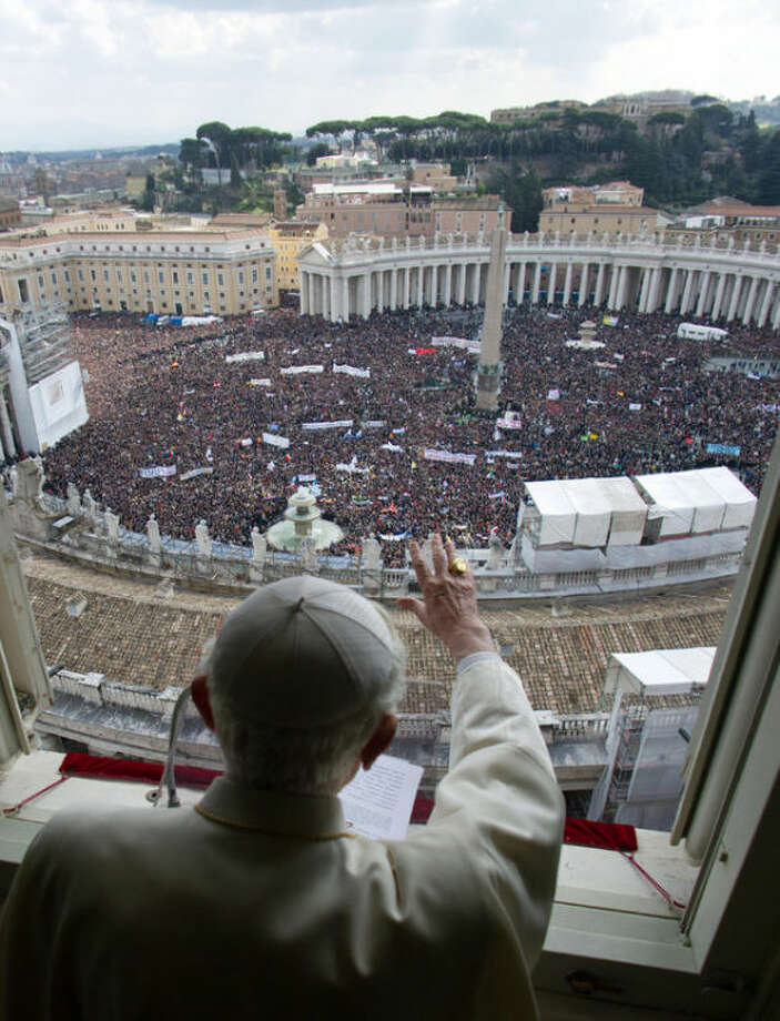 FILE -- In this photo from files taken on Feb. 24, 2013 and provided by the Vatican newspaper L'Osservatore Romano, Pope Benedict XVI delivers his blessing during his last Angelus noon prayer, from the window of his studio overlooking an overcrowded St. Peter's Square, at the Vatican. Planning for the moment when the next pope is proclaimed to the world, and for the installation ceremony a few days later, is a big-time guessing game. And that adds up to an ungodly logistical headache for the city of Rome. Nearly everything went smoothly for Benedict's last public appearances, although some faithful panicked during the retired pope's penultimate Sunday blessing from his studio window, when thousands of last-minute arrivals tried to squeeze through three narrow openings through a metal fence ringing the edge of the square. (AP Photo/L'Osservatore Romano, ho)