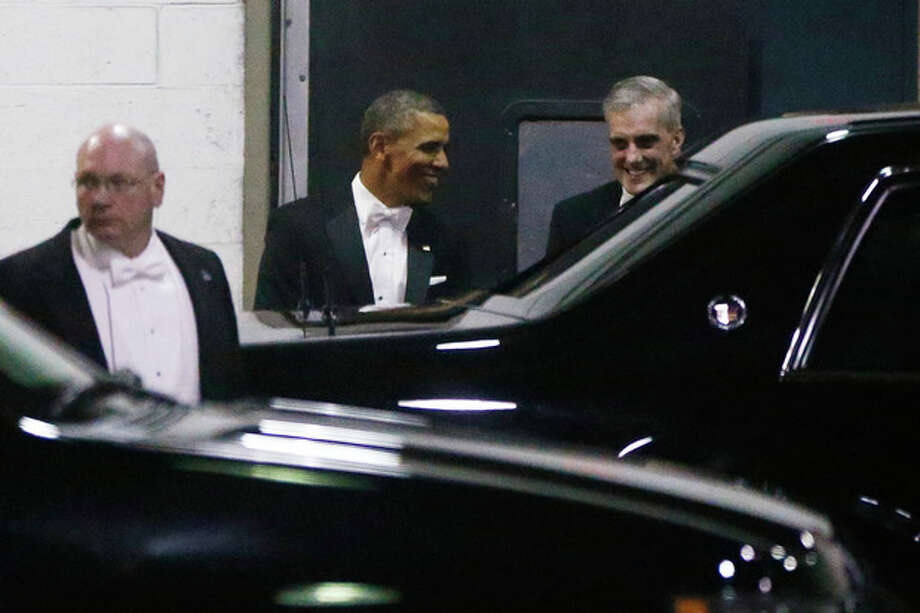President Barack Obama walks with Chief of Staff Denis McDonough, right, as they leave the Gridiron Dinner through a loading area at a hotel in Washington, Saturday, March 9, 2013. (AP Photo/Charles Dharapak) / AP