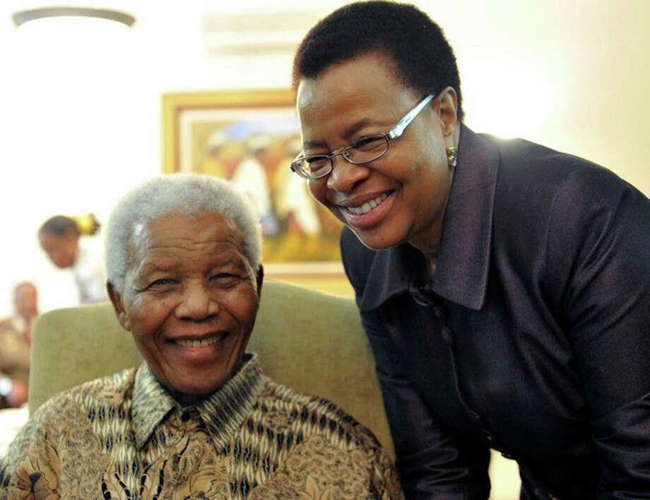 "FILE - May 16, 2011 file photo supplied by the South African Government Communications and Information Services, GCIS, showing former South African President Nelson Mandela and his wife Graca Machel at his home in Johannesburg, South Africa. Mandela was admitted to a hospital on Saturday March 9 2013 for a scheduled medical check-up and doctors say there is no cause for ""alarm,"" the president's office said. Presidential spokesman Mac Maharaj said 94-year-old Mandela went in the afternoon for tests ""to manage existing conditions in line with his age"" at a hospital in Pretoria. (AP Photo/Elmond Jiyane-GCIS, File) / AP"