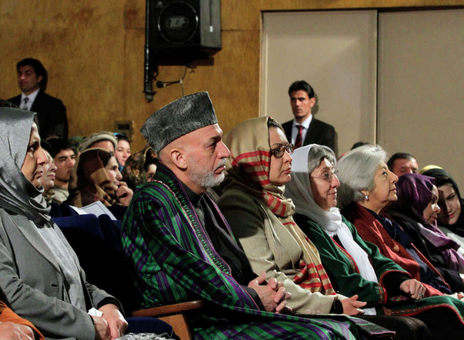 Afghan President Hamid Karzai sits among the audience prior to his nationally televised speech about the state of Afghan women in Kabul, Afghanistan, Sunday, March, 10, 2013. Karzai on Sunday accused the Taliban and the U.S. of working in concert to convince Afghans that violence will worsen if most foreign troops leave as planned by the end of next year. Karzai says two deadly suicide bombings on Saturday show the insurgent group is conducting attacks to help show that international forces will still be needed to keep the peace after their current combat mission ends in 2014. (AP Photo/Ahmad Jamshid) / AP