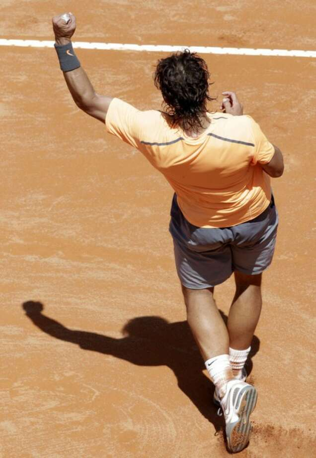 Spain's Rafael Nadal celebrates after defeating Serbia's Novak Djokovic in the final match at the Italian Open tennis tournament, in Rome, Monday, May 21, 2012. Nadal won 7-5, 6-3. (AP Photo/Riccardo De Luca)
