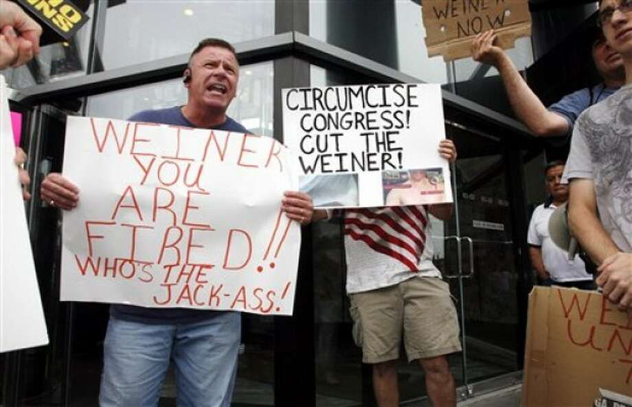 Queens resident Kevin Hiltunen, 47, takes part in a rally calling for the resignation of U.S. Rep. Anthony Weiner, D-N.Y., in front of his in New York office Sunday, June 12, 2011. Weiner announced Saturday that he was entering professional treatment at an undisclosed location and wanted a leave of absence from Congress. A statement from an aide did not say where he would receive treatment or what type was involved. (AP Photo/David Karp)