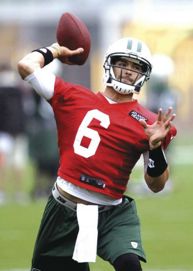 AP photoNew York Jets quarterback Mark Sanchez throws during a workout session Thursday at the team's practice facility in Florham Park, N.J. Sanchez looked sharp during the session.