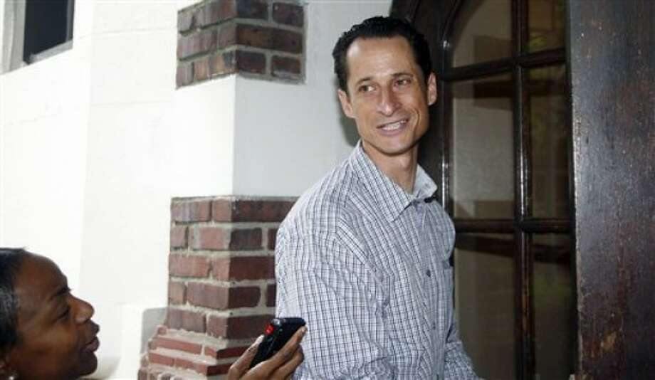 US Congressman Anthony Weiner D-NY enters his home in New York after going to the local laundromat, taking money out of an ATM machine and saying hello at a real estate office he also received greetings and support from people on the street Saturday, June 11, 2011 (AP Photo/David Karp)