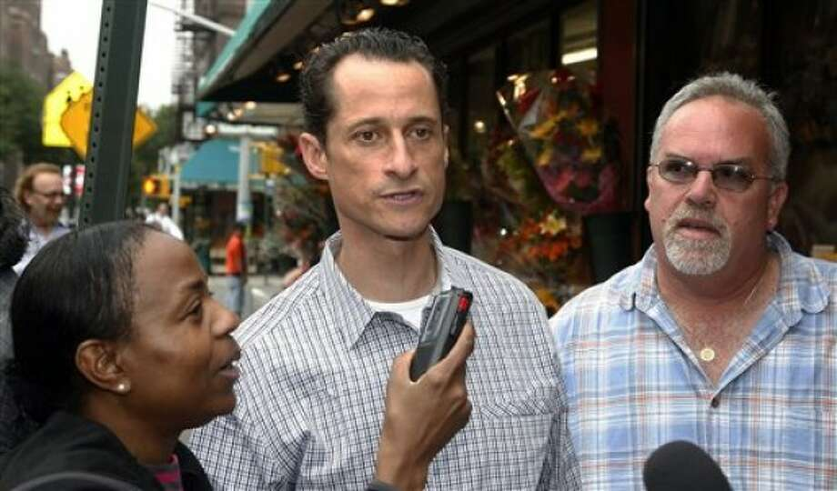 Rep. Anthony Weiner, D-N.Y., is interviewed by New York Post reporter Georgett Roberts and photographer Anthony Fioranelli as he walks down the street near his home in the Queens borough of New York Saturday, June 11, 2011. (AP Photo/David Karp)