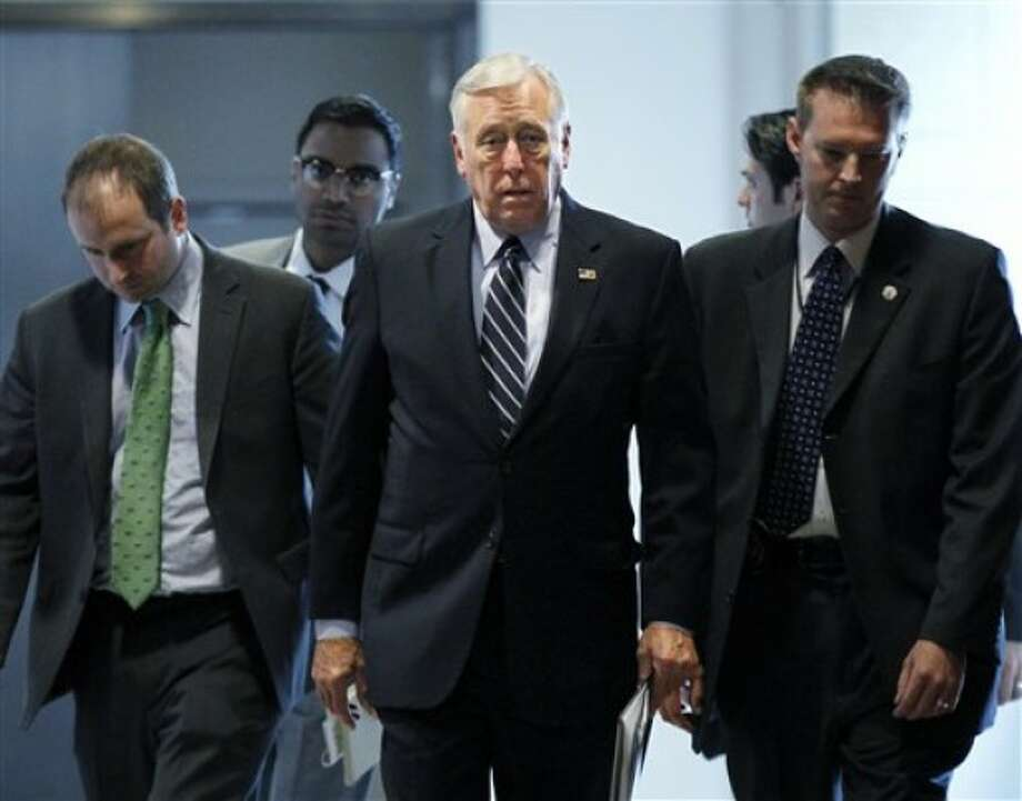 """House Minority Whip Steny Hoyer, D-Md., center, walks to a ceremony to accept an award for bipartisan leadership given by Bradley University, on Capitol Hill in Washington, Monday, June 13, 2011. Hoyer, the No. 2 House Democrat, has called the """"sexting"""" scandal consuming Rep. Anthony Weiner, D-NY, """"bizarre and unacceptable behavior"""" and that it would be """"extraordinarily difficult"""" for Weiner to be effective in Congress. (AP Photo/J. Scott Applewhite)"""