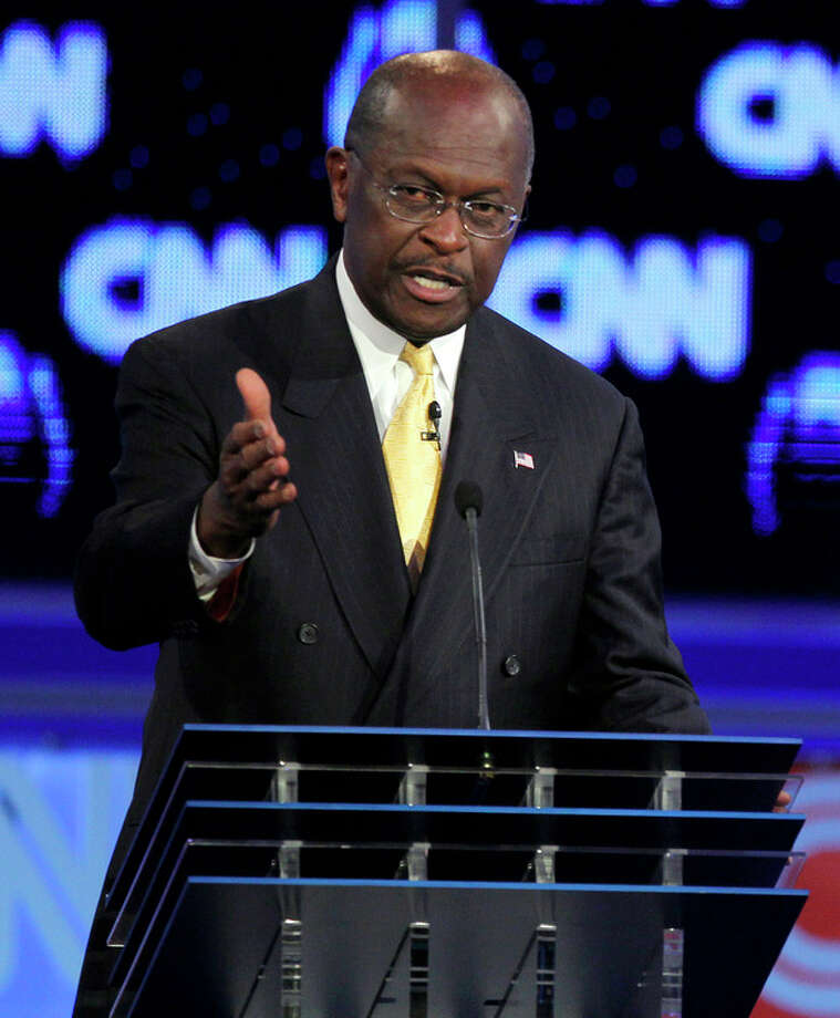 Republican presidential candidate businessman Herman Cain speaks during a Republican presidential debate Tuesday, Oct. 18, 2011, in Las Vegas. (AP Photo/Chris Carlson) / A