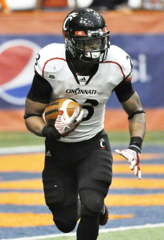 Cincinnati's Isaiah Pead looks for an opening in the Syracuse defense during the fourth quarter of an NCAA college football game in Syracuse, N.Y., Saturday, Nov. 26, 2011. Cincinnati won 30-13. (AP Photo/Kevin Rivoli)