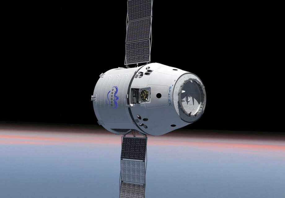 This computer generated image provided by SpaceX shows their Dragon spacecraft with solar panels deployed. The world's first private supply ship flew tantalizingly close to the International Space Station on Thursday, May 24, 2012 but did not stop, completing a critical test in advance of the actual docking scheduled for Friday, May 25, 2012. (AP Photo/SpaceX) / SpaceX