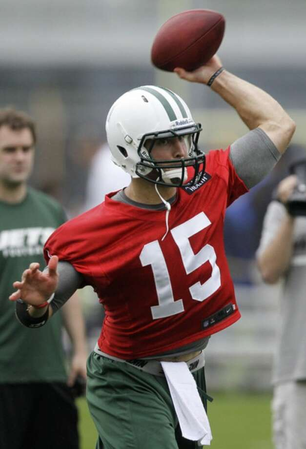 New York Jets quarterback Tim Tebow throws during NFL football practice, Thursday, May 24, 2012, in Florham Park, N.J. (AP Photo/Julio Cortez)
