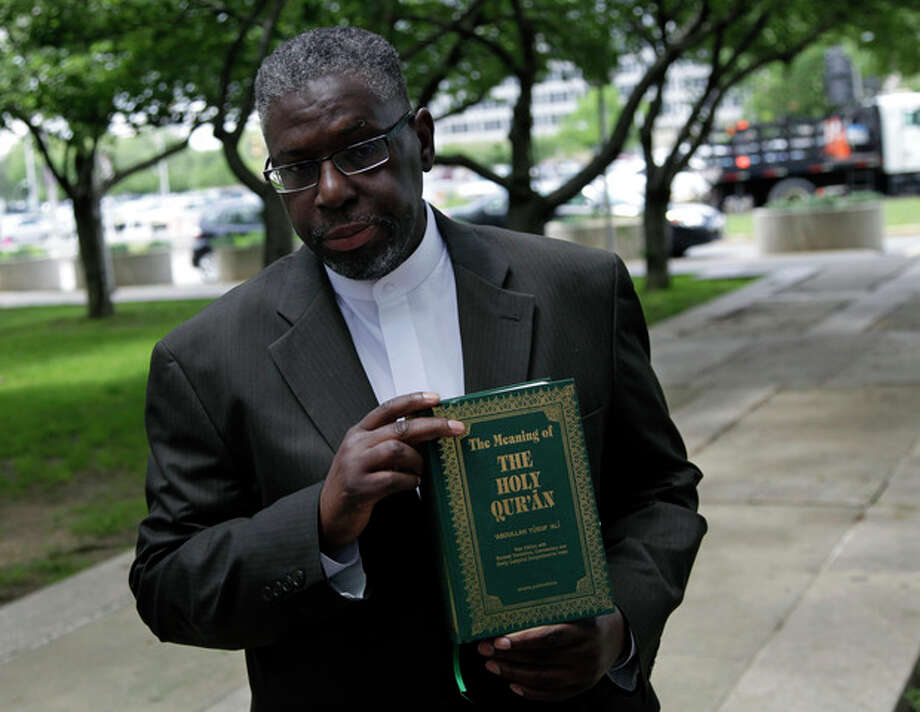 Imam Mustafa El-Amin holds a Quran that he plans to give to New Jersey Attorney General Jeffrey S. Chiesa at a meeting with religious leaders in Trenton, N.J., Thursday, May 24, 2012. Following a three-month review, Gov. Chris Christie's administration said Thursday that New York City police did not violate New Jersey laws when they conducted surveillance of Muslim businesses, mosques and student groups, rejecting demands by Muslim leaders for a formal investigation and a clampdown on cross-border police operations. (AP Photo/Mel Evans) / AP