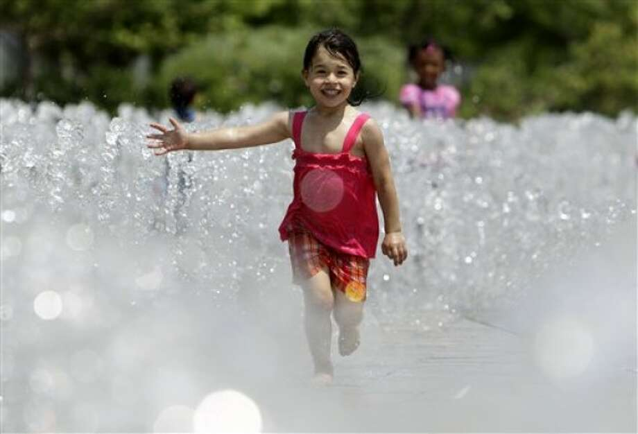 Meyah Taylor, 4, of Detroit runs through a fountain along River Walk in Detroit, Wednesday, June 8, 2011. (AP Photo/Paul Sancya)