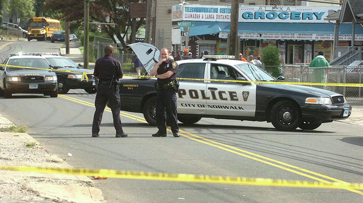 Hour photo / Alex von Kleydorff Norwalk Police investigate a fatal shooting late Wednesday afternoon at 119 South Main St. in Norwalk.