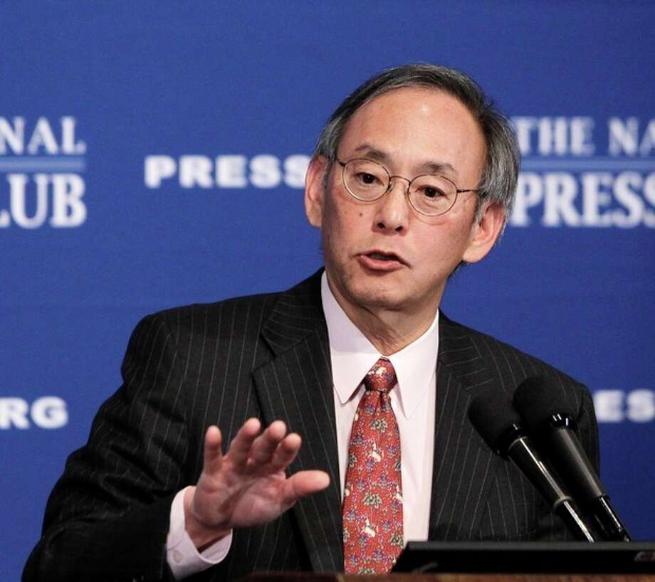 FILE - In this Nov. 29, 2010 file photo, Energy Secretary Steven Chu gives a speech at the National Press Club in Washington. Top officials at the White House circulated a plan calling for the ouster of Energy Secretary Steven Chu and other top Energy Department officials as the administration braced for a political storm brewing over the failing solar energy company Solyndra. (AP Photo/Charles Dharapak, File) / AP2010