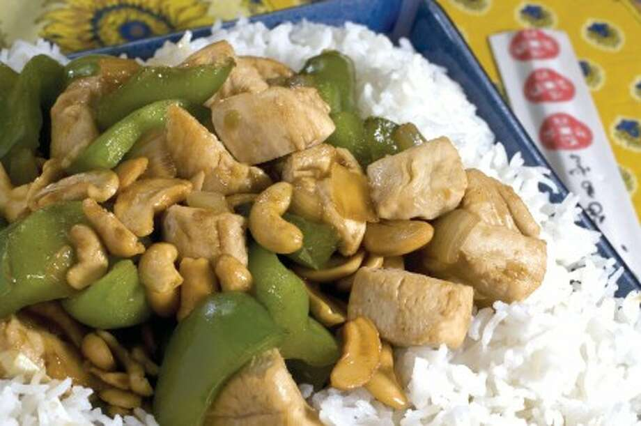 This Dec. 12, 2010 photo shows homemade cashew chicken in Concord, N.H. This is an easy dish that dirties just one pan and one bowl and comes together in just about 20 minutes. (AP Photo/Larry Crowe)