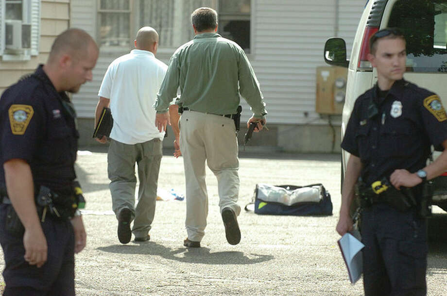 Hour Photo/ Alex von Kleydorff. Norwalk Police investigate a shooting late Wednesday Afternoon at 119 South Main St. / 2012 The Hour Newspapers