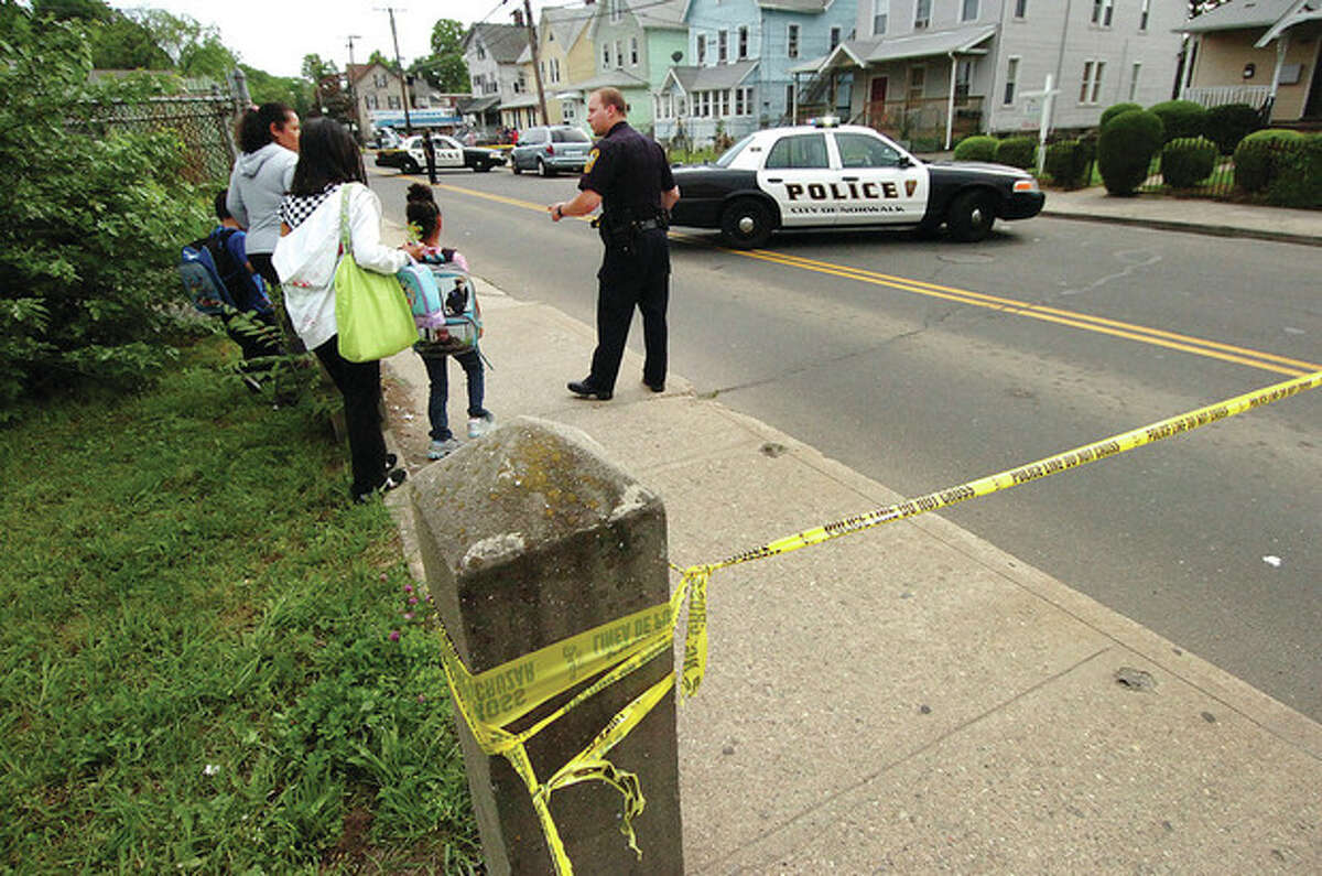 Hour Photo/ Alex von Kleydorff. Norwalk Police investigate a shooting late Wednesday Afternoon at 119 South Main St.