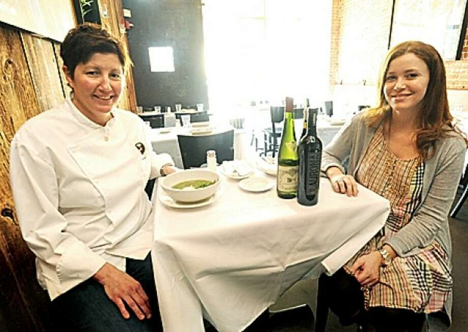 Jodi Bernhard, executive chef at Barcelona in South Norwalk and wine director Gretchen Thomas. hour photo matthew vinci