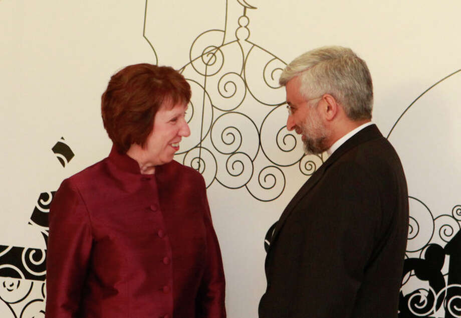Iran's Chief Nuclear Negotiator Saeed Jalili, right, chats with EU Foreign Policy Chief Catherine Ashton in Baghdad, Iraq, Wednesday, May 23, 2012. Negotiators from the U.S. and five other world powers sat down Wednesday with a team of Iranian diplomats to try to hammer out specific goals in the years-long impasse over Tehran's nuclear program. (AP Photo/Hadi Mizban) / AP