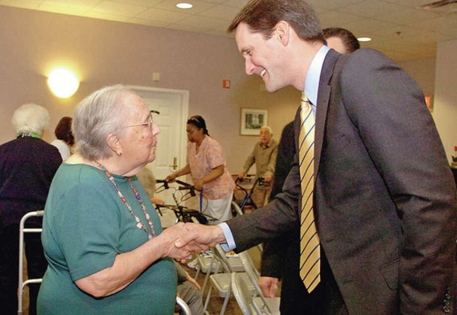 Congressman Jim Himes talks to seniors at The Marvin including resident Marian O'Sullivan Wednesday.Hour photo / Erik Trautmann / (C)2012, The Hour Newspapers, all rights reserved
