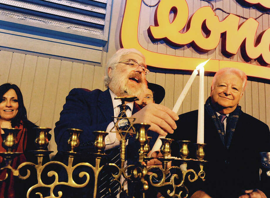 Rabbi Yehoshua Hecht sets off the Stew Leonard's annual menorah lighting celebration Tuesday night where local dinitaries and the public observed the Festival of Lights. hour photo/Matthew Vinci / (C)2011, The Hour Newspapers, all rights reserved