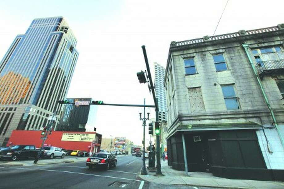 In this Monday, Dec. 27, 2010 photo, the closed and boarded building that once housed the Eagle Saloon, where Louis Armstrong and Buddy Bolden used to perform, is seen on the right at the corner of South Rampart and Perdido Streets in downtown New Orleans. (AP Photo/Gerald Herbert)