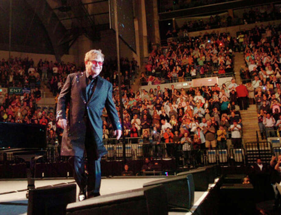 ADVANCE FOR WEEKEND, MAY 26-27- In this April 21, 2012, photo, Elton John hits the stage for a concert at Memorial Coliseum in Fort Wayne, Ind. The sold-out concert had ticket prices up to $139. Booking big acts - even for big venues like the Coliseum - has never been easy. But in recent years it has gotten much more complicated. Today, the industry is dominated by a few big promoters but is also teeming with agents, managers and venues competing against one another. And all of them want the best deal for themselves and their clients. (AP Photo/The Journal Gazette, Samuel Hoffman) NEWS-SENTINEL OUT / The Journal Gazette