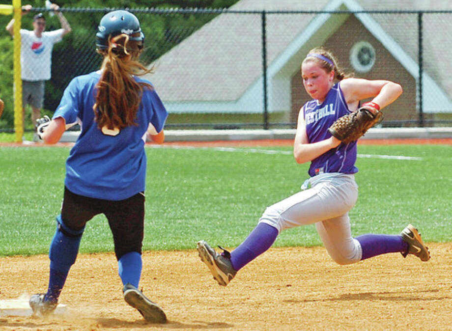 Westhill second baseman tries to get to the bag ahead of a Darien baserunner during their loss to Darien in the FCIAC softball final at Sacred Heart.Hour photo / Erik Trautmann / ©2012 the hour