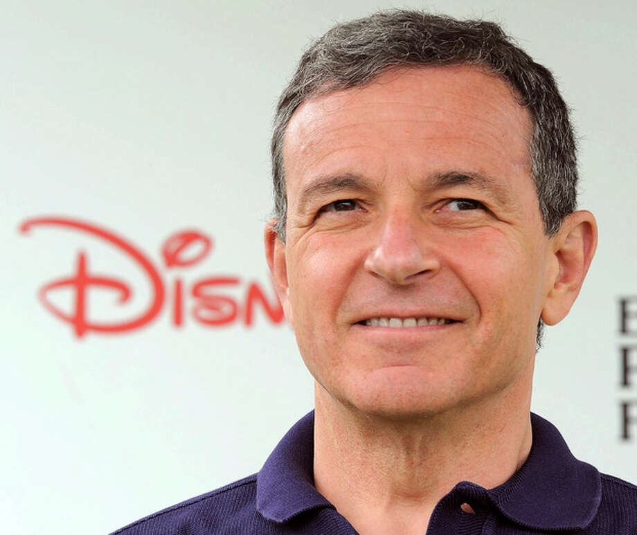FILE - In this June 12, 2011 file photo, Robert Iger srrives at The 22nd Annual A Time for Heroes Celebrity Carnival Sponsored by Disney at Wadsworth Theater in Los Angeles. Iger is one of the top 10 highest paid CEOs at publicly held companies in America last year, according to calculations by Equilar, an executive compensation data firm, and The Associated Press. The Associated Press formula calculates an executive's total compensation during the last fiscal year by adding salary, bonuses, perks, above-market interest the company pays on deferred compensation and the estimated value of stock and stock options awarded during the year. (AP Photo/Katy Winn, File) / AP2011