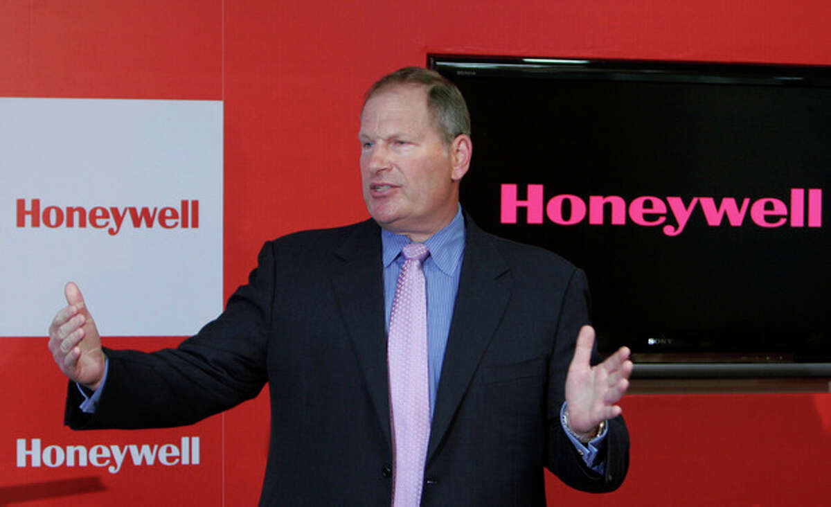 FILE - In this May 7, 2009 file photograph, Honeywell Chairman and Chief Executive Officer Dave Cote speaks after inaugurating the company's new facility in Bangalore, India. Cote is one of the top 10 highest paid CEOs at publicly held companies in America last year, according to calculations by Equilar, an executive compensation data firm, and The Associated Press. The Associated Press formula calculates an executive's total compensation during the last fiscal year by adding salary, bonuses, perks, above-market interest the company pays on deferred compensation and the estimated value of stock and stock options awarded during the year. (AP Photo/Aijaz Rahi, file)