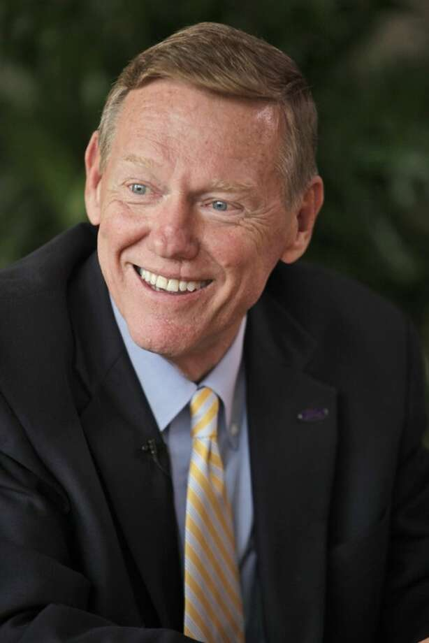 FILE - In this Friday, Sept. 2 2011 file photo, Ford Motor Company CEO Alan Mulally smiles during an interview with The Associated Press in New York. Mulally is one of the top 10 highest paid CEOs at publicly held companies in America last year, according to calculations by Equilar, an executive compensation data firm, and The Associated Press. The Associated Press formula calculates an executive's total compensation during the last fiscal year by adding salary, bonuses, perks, above-market interest the company pays on deferred compensation and the estimated value of stock and stock options awarded during the year. (AP Photo/Mary Altaffer)