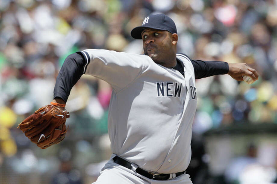 CORRECTS INNING TO SECOND, INSTEAD OF THIRD - New York Yankees' CC Sabathia pitches against the Oakland Athletics during the second inning of a baseball game in Oakland, Calif., Saturday, May 26, 2012. (AP Photo/Jeff Chiu) / AP